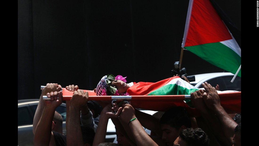 """Mourners carry the body of Muhyi Sedqi al-Tabakhi during his funeral in the West Bank town of Al-Ram on Wednesday, July 20. The Palestinian Ministry of Health said the 12-year-old boy was shot and killed by Israeli forces in the West Bank. Israel police spokeswoman Luba Samri <a href=""""http://www.cnn.com/2016/07/19/middleeast/west-bank-palestinian-boy/index.html"""" target=""""_blank"""">disputed the claim</a> and said Israeli forces never opened fire."""