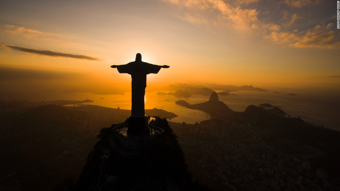 """The sun rises behind the Christ the Redeemer statue in Rio de Janeiro on Tuesday, July 19. <a href=""""http://www.cnn.com/2016/07/15/world/gallery/week-in-photos-0715/index.html"""" target=""""_blank"""">See last week in 31 photos</a>"""