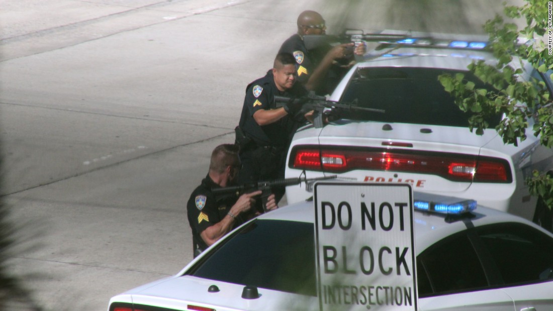 """Police block a highway in Baton Rouge, Louisiana, after a man killed three law enforcement officers and wounded three others on Sunday, June 17. <a href=""""http://www.cnn.com/2016/07/17/us/baton-route-police-shooting"""" target=""""_blank"""">The ambush</a> came nearly two weeks after the police shooting of Alton Sterling, a black Baton Rouge resident, and officials said police were targeted because of it."""
