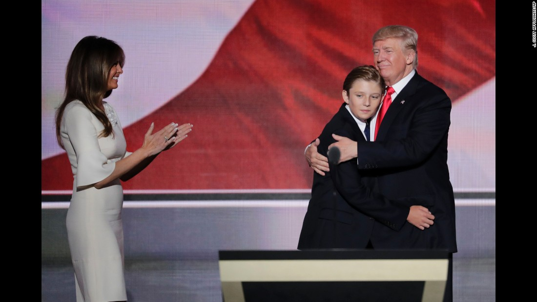 Trump hugs his son Barron after his address, which lasted well over an hour.