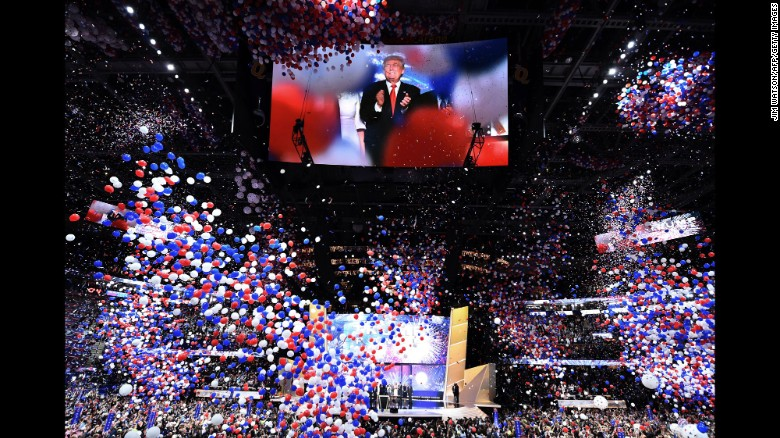 Trump is seen on screen as balloons fall from the ceiling of Quicken Loans Arena.