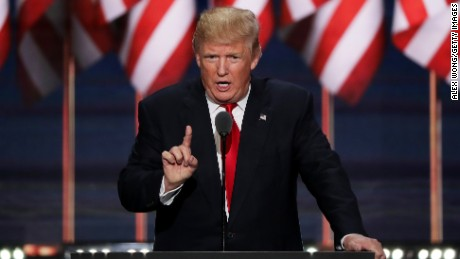 Republican presidential candidate Donald Trump delivers a speech during the evening session on the fourth day of the Republican National Convention on July 21, 2016 at the Quicken Loans Arena in Cleveland, Ohio. Republican presidential candidate Donald Trump received the number of votes needed to secure the party's nomination. An estimated 50,000 people are expected in Cleveland, including hundreds of protesters and members of the media. The four-day Republican National Convention kicked off on July 18.