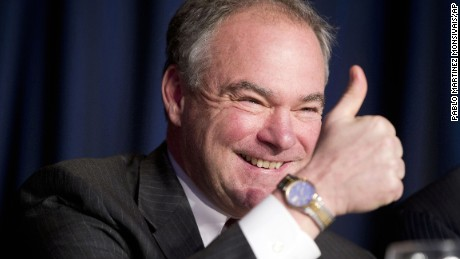 Sen. Tim Kaine, D-Va., gives a 'thumbs-up' as he takes his seat at the head table for the National Prayer Breakfast in Washington. Kaine is one of several Democrats that Hillary Clinton is considering for her vice presidential running mate.