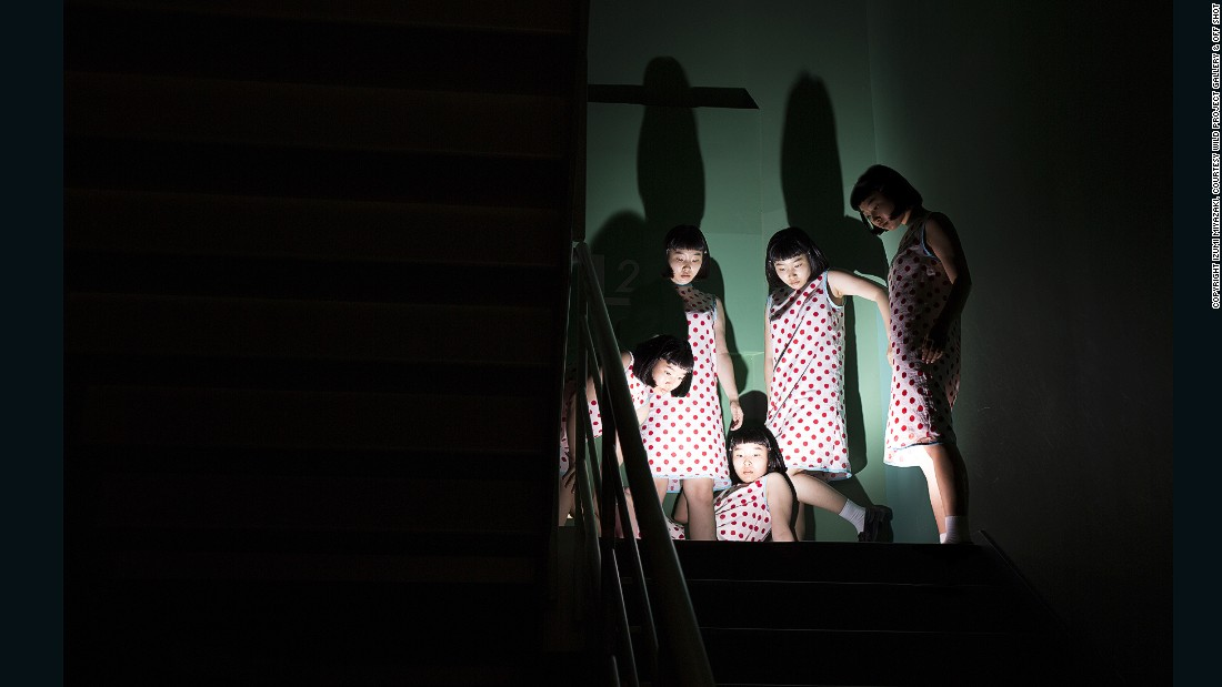 Girls, 2015 -- In a departure from her selfie-style portraits, Miyazaki depicts a group of seemingly identical Japanese women, standing together and inspecting something below -- as if gazing into an ominous hole.