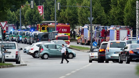 Police and firefighters are seen near a shopping mall amid a shooting on July 22, 2016 in Munich. Several people were killed on Friday in a shooting rampage by a lone gunman in a Munich shopping centre, media reports said / AFP / dpa / Matthias Balk / Germany OUT        (Photo credit should read MATTHIAS BALK/AFP/Getty Images)