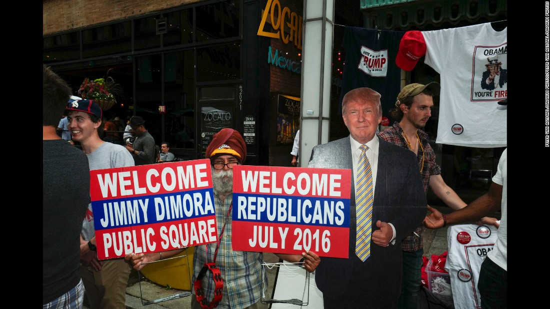 """A cut-out of Donald Trump seems to welcome Republicans to the Republican National Convention in Cleveland. CNN sent photographer <a href=""""http://www.petervanagtmael.net/"""" target=""""_blank"""">Peter van Agtmael</a> into the crowds of downtown Cleveland to get a handle on what it's like away from the politicians and delegates."""