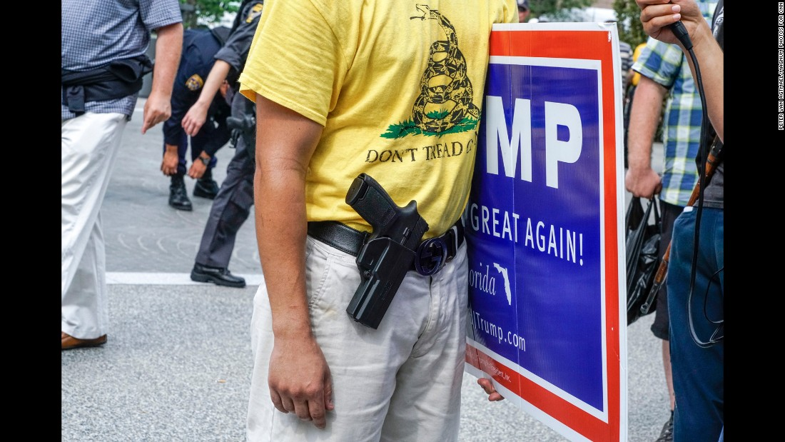 """A gun is seen <a href=""""http://www.cnn.com/2016/07/20/politics/gallery/outside-rnc-van-agtmael/index.html"""" target=""""_blank"""">outside the Republican National Convention.</a> """"Open carry"""" gun laws allow Ohio's licensed firearm owners to wear their weapons in public."""