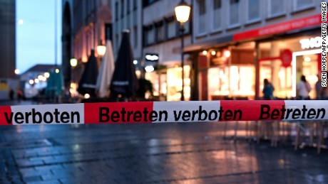 Police sign blocks the entrance to Odeon square following shootings at a shopping mall earlier on July 22, 2016 in Munich. Six people were killed and several gravely injured on Friday in a shooting rampage at a Munich shopping centre, with the attackers still believed to be at large. / AFP / dpa / Sven Hoppe / Germany OUT        (Photo credit should read SVEN HOPPE/AFP/Getty Images)