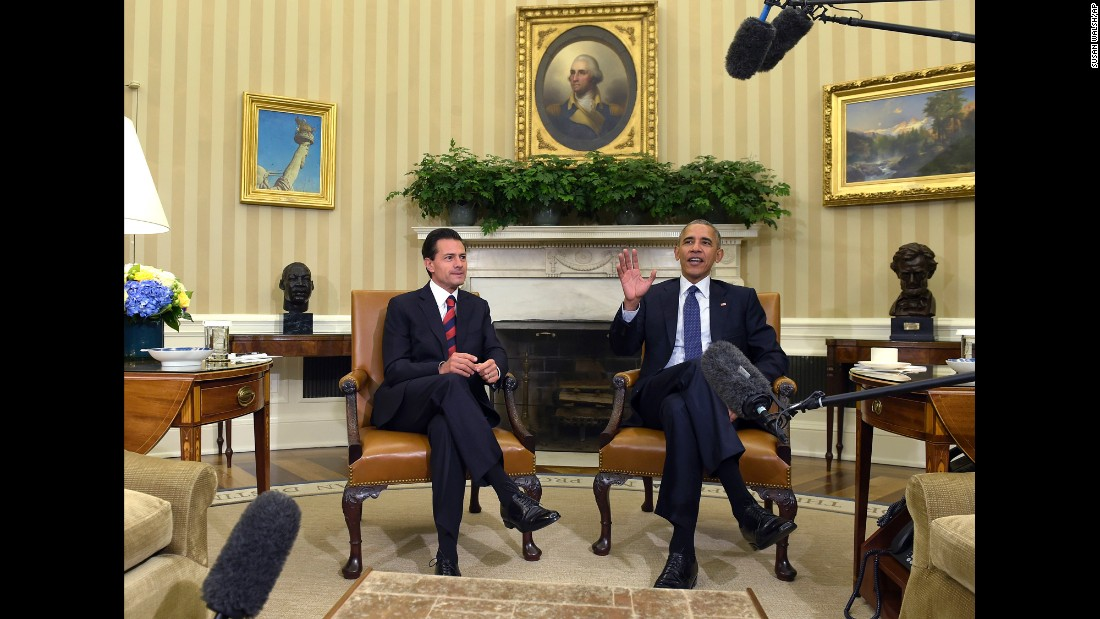"""U.S. President Barack Obama, right, meets with Mexican President Enrique Pena Nieto in the White House Oval Office on Friday, July 22. The two <a href=""""http://www.cnn.com/2016/07/22/politics/obama-trump-mexican-president-pena-nieto-visit/"""" target=""""_blank"""">met for talks</a> about trade, climate change and how to counter drug trafficking."""