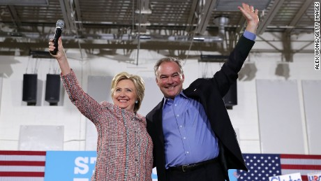 Democratic presidential candidate Hillary Clinton (L) and U.S. Sen. Tim Kaine (D-VA) (R) acknowledge the crowd during a campaign event at Ernst Community Cultural Center at Northern Virginia Community College July 14, 2016 in Annandale, Virginia.