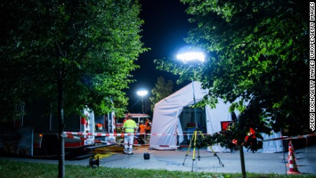 MUNICH, GERMANY - JULY 22:  A mobile care and help center is erected in a parking area of a Kentucky Fried Chicken near the Olympia Einkaufzentrum (OEZ) after a shooting at the shopping mall on July 22, 2015 in Munich, Germany. According to reports, nine people have been killed and an unknown number injured in a shooting at a shopping centre in the north-western Moosach district in Munich. (Photo by Joerg Koch/Getty Images)