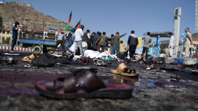 The sandals of Afghan protesters remain at the scene.