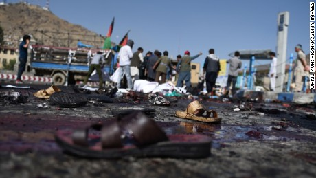 The sandals of Afghan protesters remain at the scene of a suicide attack that targeted crowds of minority Shiite Hazaras during a demonstration at the Deh Mazang Circle in Kabul on Saturday July 23, 2016.