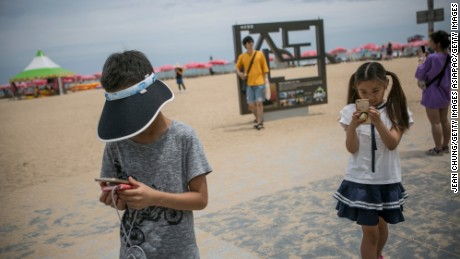 Children play Pokemon Go on July 15, 2016 in Sokcho, South Korea.
