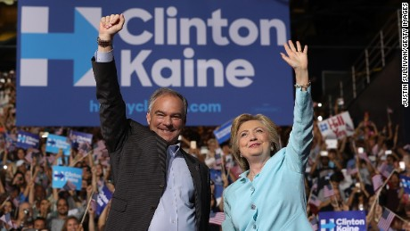 Democratic presidential candidate former Secretary of State Hillary Clinton and Democratic vice presidential candidate U.S. Senator Tim Kaine greet supporters during a campaign rally at Florida International University Panther Arena on Saturday July 23 in Miami, Florida.