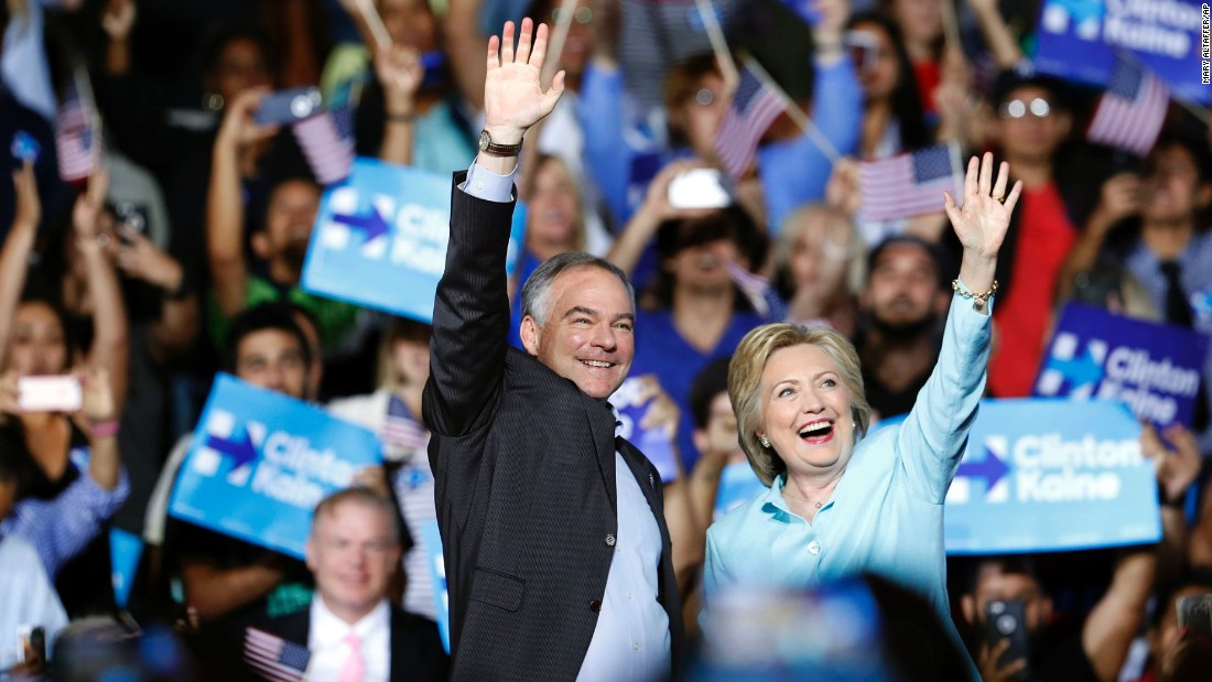 Presumptive Democratic presidential nominee Hillary Clinton arrives with Sen. Tim Kaine at a rally in Miami on Saturday, July 23. Clinton has selected Kaine as her running mate. Kaine has represented Virginia in the Senate since January 2013. He was governor from 2006 to 2010.