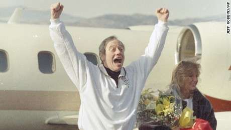 Thomas Sutherland jumps and shouts after arriving on Dec. 1, 1991 at Fort Collins-Loveland Airport outside his hometown of Fort Collins, Colorado. Sutherland spent six and a half years as a hostage in Lebanon before being released November 18, 1991. Sutherland's daughter Kit is at right.