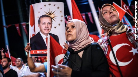 Women look on during a Pro-Erdogan rally in Taksim square in Istanbul on July 22, 2016, following the failed military coup attempt of July 15.  Turkey detained 283 members of the presidential guard of Recep Tayyip Erdogan after last week's attempted coup, a government official said July 22. The guard are members of the special forces regiment stationed at the presidential palace in Ankara. There are at least 2,500 members, according to local media.  / AFP / OZAN KOSE        (Photo credit should read OZAN KOSE/AFP/Getty Images)