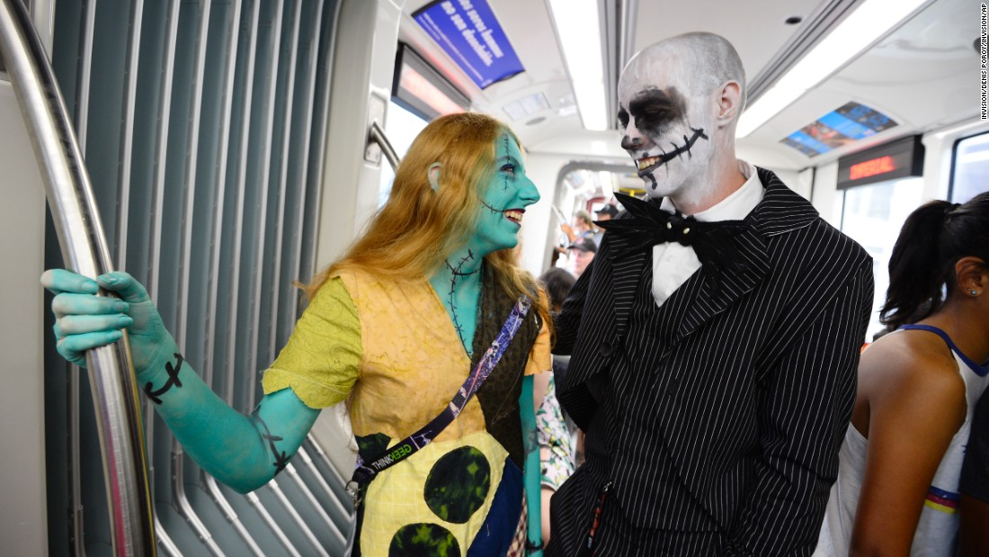 "Kathy Green and David McClow, dressed as characters from Tim Burton's ""The Nightmare Before Christmas,"" ride the trolley to the convention center."