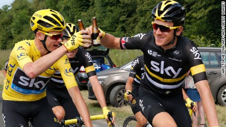 Chris Froome (left) Geraint Thomas drink a celebratory beer at the start of the 113 km twenty-first and last stage of the 103rd edition of the Tour de France.