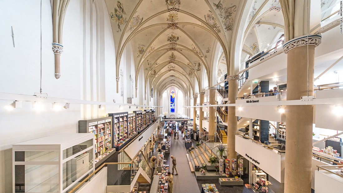 """If libraries are cathedrals of learning, then it's not a huge stretch to place a bookshop in a church. <a href=""""http://waandersindebroeren.nl/"""" target=""""_blank"""">Waanders In de Broeren</a> in Zwolle sits within a converted 15th century Dominican church. The refit builds in three floors but pays respect to the original vaulted ceiling, while architects <a href=""""http://www.bkpunt.nl/#0"""" target=""""_blank"""">BK. Architecten</a> transformed the building's transepts into reading rooms, complete with stained glass windows."""