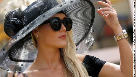 CHICHESTER, ENGLAND - JULY 31:  A race goer on day four of the Qatar Goodwood Festival at Goodwood Racecourse on July 31, 2015 in Chichester, England.  (Photo by Tristan Fewings/Getty Images for Qatar Goodwood Festival)