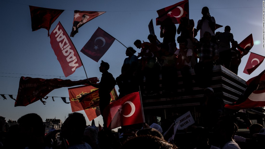 Thousands of supporters from Turkish President Recep Tayyip Erdogan's AKP party and the opposition CHP join forces Sunday, July 24, in an anti-coup rally in Istanbul's Taksim Square.