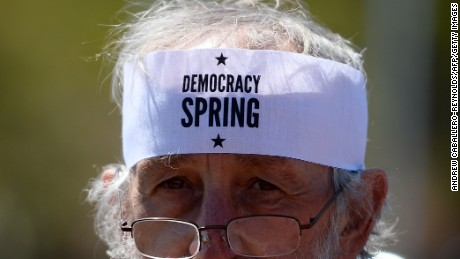A protester looks on during a Democracy Spring demonstration on Capitol Hill  in Washington, DC on April 13, 2016, calling to change voting laws and campaign finance.