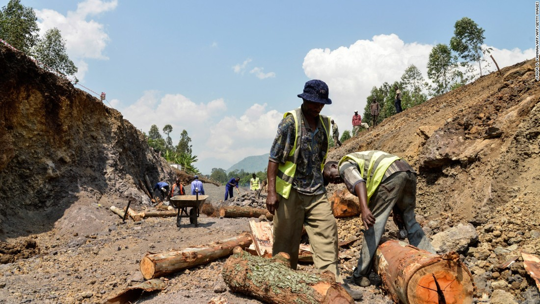 Workers in the Virunga National Park digging and preparing the canal in Matebe in 2014. The project began a month after government soldiers backed by UN troops defeated rebels of the Movement of March 23 (M23) who had seized control of the area.
