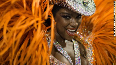 A reveller of Imperatriz samba school performs during the second night of the carnival parade at the Sambadrome in Rio de Janeiro, Brazil, on february 09, 2016.