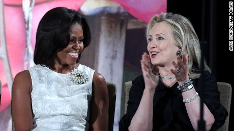 First lady Michelle Obama (L) listens to U.S. Secretary of State Hillary Clinton during the presentation ceremony of the International Women of Courage Awards at the State Department March 8, 2012 in Washington, DC.