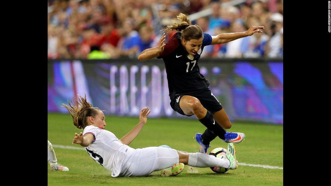 Costa Rica's Gloriana Villalobos slide-tackles U.S. winger Tobin Heath during an exhibition match in Kansas City, Kansas, on Friday, July 22.