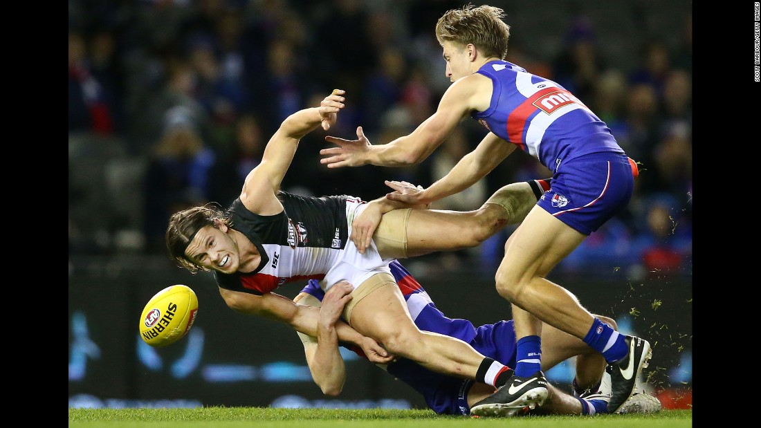 Maverick Weller of the St. Kilda Saints is tackled by Western Bulldogs during an Australian Football League match in Melbourne on Saturday, July 23.