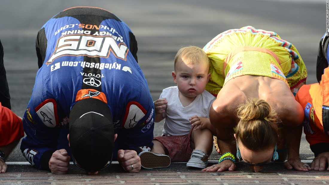 NASCAR driver Kyle Busch -- joined by his wife, Samantha, and their son, Brexton -- kisses the bricks at Indianapolis Motor Speedway on Saturday, July 23. Busch had just won the Xfinity Series race there. He won the Sprint Cup race the next day for a weekend sweep.