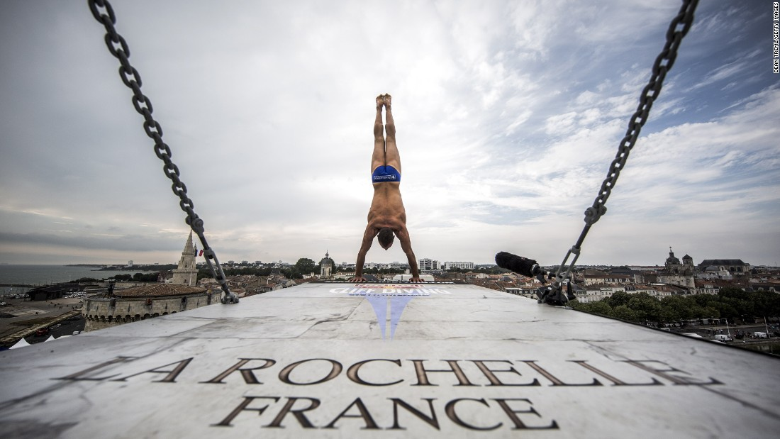 Czech diver Michal Navratil prepares to launch himself from a platform in La Rochelle, France, on Thursday, July 21. He was training at the fourth stop of the Red Bull Cliff Diving World Series.