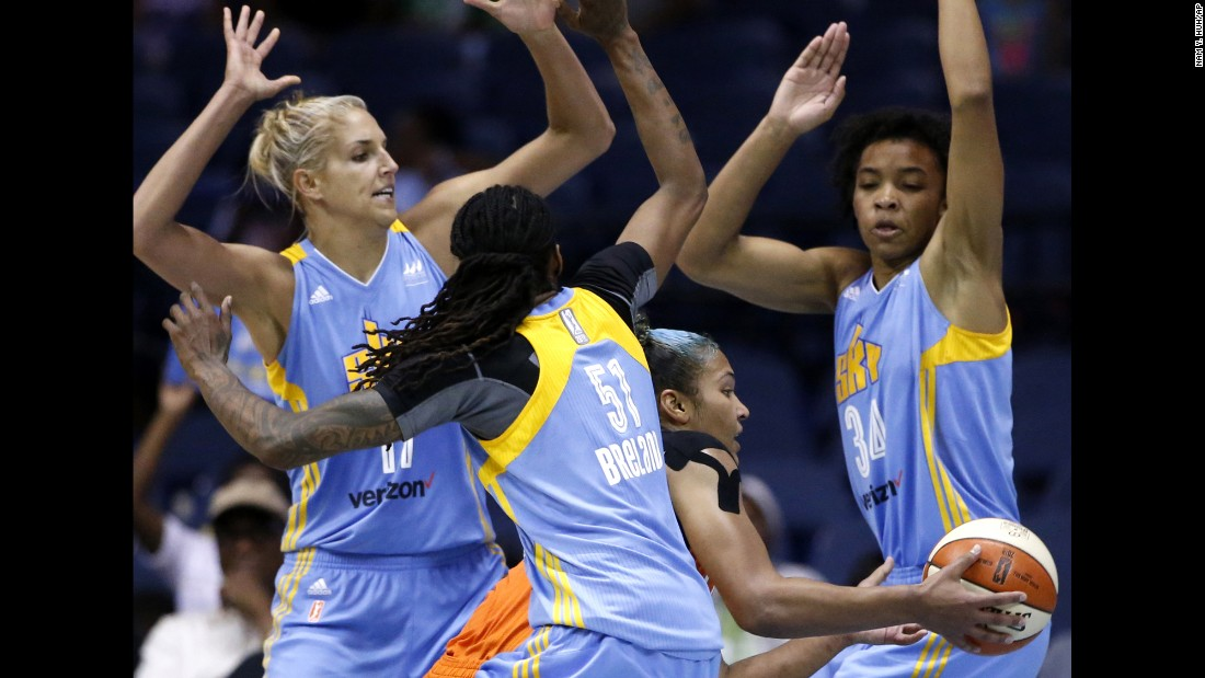 Connecticut's Alyssa Thomas is surrounded by Chicago Sky defenders during a WNBA game in Rosemont, Illinois, on Friday, July 22.