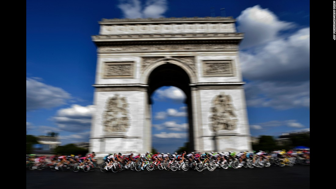 """Cyclists race past the Arc de Triomphe in Paris during the last stage of the Tour de France on Sunday, July 24. <a href=""""http://www.cnn.com/2016/07/19/sport/gallery/what-a-shot-sports-0719/index.html"""" target=""""_blank"""">See 24 amazing sports photos from last week</a>"""