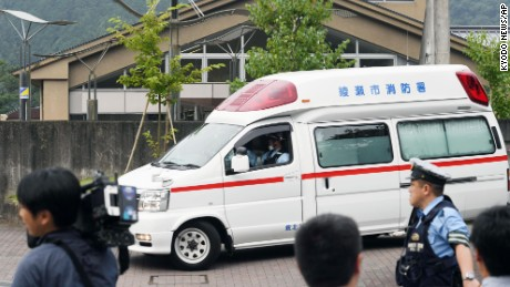 An ambulance moves past in front of a facility for the handicapped where a number of people were killed and dozens injured in a knife attack Tuesday, July 26, 2016,  in Sagamihara, outside Tokyo.