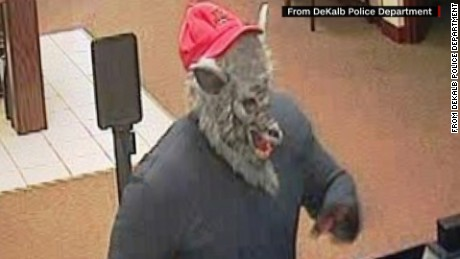 Bank robber in wolf mask has news anchors howling. CNN's Jeanne Moos reports on anchors in stitches.    Wolf Robber Giggles   A story about a bank robber in a wolf mask sent a pair of Chicago TV anchors into a live fit of the giggles. Maybe it was the baseball hat on top of the wolf mask that did it. The male anchor, Ben Bradley, blamed his co-anchor saying ?It?s Stacey?s fault?  and he was right.  Stacey Baca could barely speak. There?s a technical term for when this happens??church giggles? is what Kathy Griffin calls it.  We?ll toss in a few other examples of out of control anchors and will update the latest info on the hunt for the wolf mask bank robber while we?re at it. The wolf was also wearing a red hat which fell off. Cops are now testing the hat for DNA.