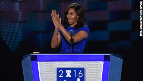 US First Lady Michelle Obama gestures during Day 1 of the Democratic National Convention at the Wells Fargo Center in Philadelphia, Pennsylvania, July 25, 2016.