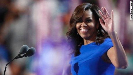 First Lady Michelle Obama takes the stage during the first day of the Democratic National Convention in Philadelphia , Monday, July 25, 2016.