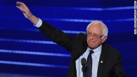 Former Presidential candidate and US Senator Bernie Sanders waves during Day 1 of the Democratic National Convention at the Wells Fargo Center in Philadelphia, Pennsylvania, July 25, 2016.
