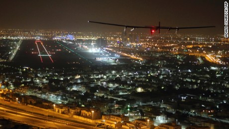The Solar Impulse 2 plane approaches to land at Al Bateen Executive Airport in Abu Dhabi, United Arab Emirates, on Tuesday, July 26, 2016. The world's first ever round-the-world flight to be powered solely by the sun's energy made history with its landing in the Emirati capital, where it first took off on an epic 22,000-mile (35,000 kilometer) journey more than a year ago (AP Photo/Adam Schreck)