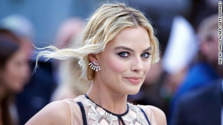 Margot Robbie poses for photographers as she arrives to attend the European premiere of the film The Legend of Tarzan in central London on July 5.
