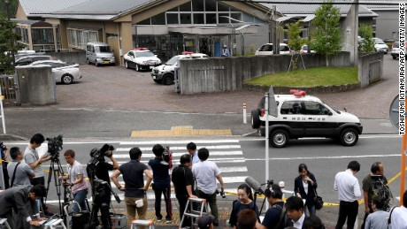 Journalists gather at the main gate of the Tsukui Yamayuri En care center where a knife-wielding man went on a rampage in the city of Sagamihara, Kanagawa prefecture, some 50 kms (30 miles) west of Tokyo on Tuesday, July 26. At least 19 people were killed when the man went on a rampage at the care centre for the mentally disabled in Japan early on Tuesday, a fire official said.