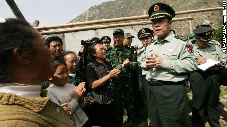 "This picture taken on May 19, 2008 shows former Chinese military leader Guo Boxiong (R) talking to locals after an earthquake hit the area in Wenchuan, in southwest China's Sichuan province. Chinese media on July 31, 2015 poured scorn on fallen military leader Guo Boxiong, accusing the ""demon"" former top general of dishonesty since his youth and his family of selling military posts for cash.     CHINA OUT       AFP PHOTO           (Photo credit should read STR/AFP/Getty Images)"