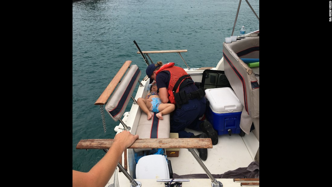 """Coast Guard Seaman Amanda Wolf performs CPR on a 2-year-old girl <a href=""""http://www.mlive.com/weather/index.ssf/2016/07/coast_guard_saves_girl_2_who_f.html"""" target=""""_blank"""">who fell off a boat and into Lake Michigan</a> on Thursday, July 21. Wolf successfully resuscitated the child."""