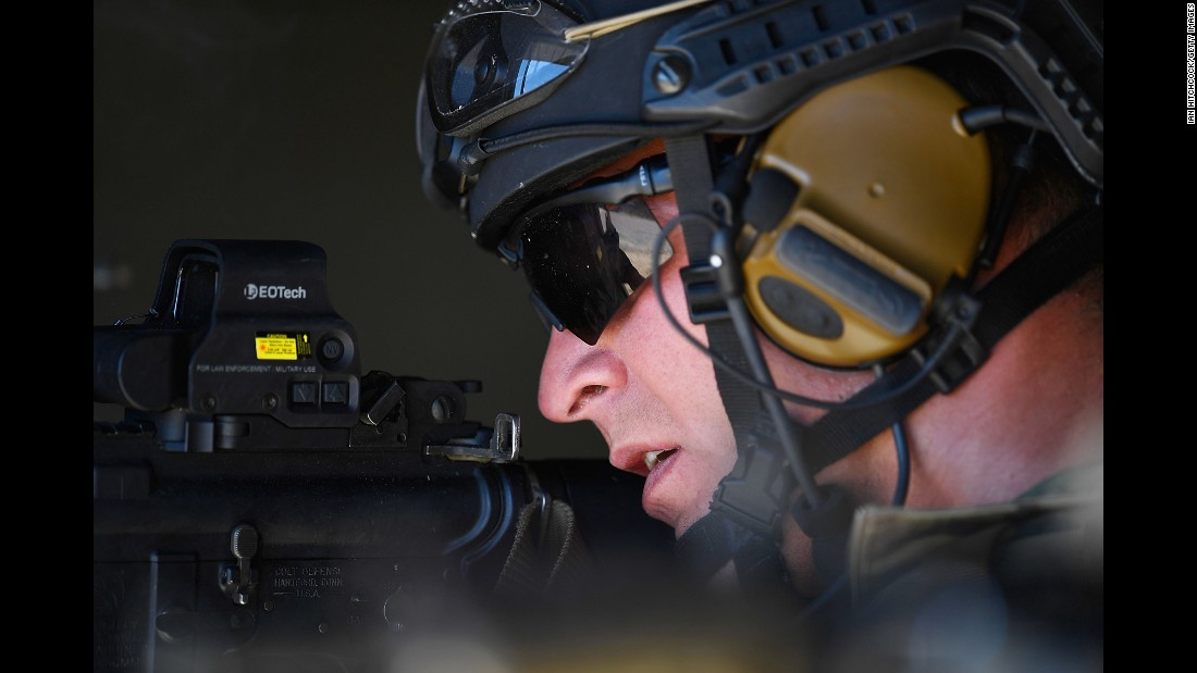 A member of the U.S. Air Force focuses on a simulated enemy during a training exercise in Townsville, Australia, on Wednesday, July 6.