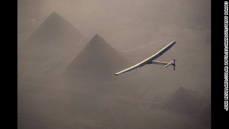 In this handout image provided by Jean Revillard from Solar Impulse 2, the solar powered plane, piloted by Swiss pioneer Andre Borschberg, is seen flying over the pyramids prior to landing in Cairo on July 13 in Giza, Eygpt.
