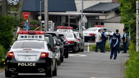 Police officers stand guard near the Tsukui Yamayuri En care centre where a knife-wielding man went on a rampage in the city of Sagamihara, Kanagawa prefecture, some 50 kms (30 miles) west of Tokyo on July 26, 2016. At least 19 people were killed when the man went on a rampage at the care centre for the mentally disabled in Japan early on July 26, a fire official said. / AFP / TOSHIFUMI KITAMURA        (Photo credit should read TOSHIFUMI KITAMURA/AFP/Getty Images)